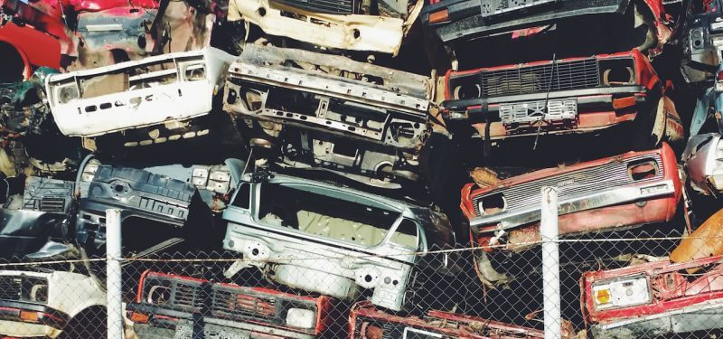 Stacked junkyard cars