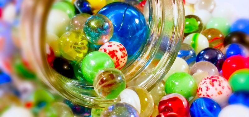 Marbles coming out of a jar