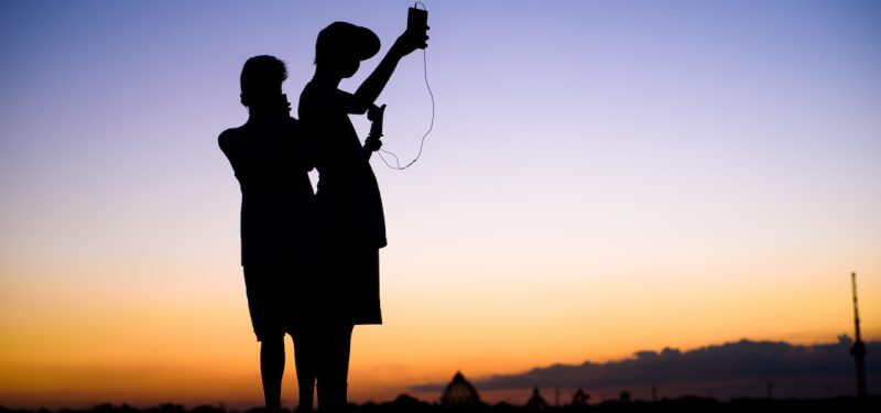 Silhouette of mobile users searching for signal