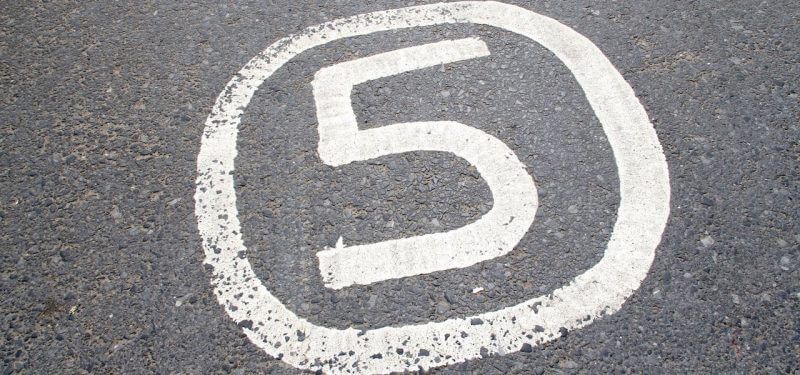 Number 5 painted on asphalt