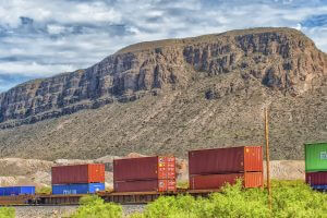 Containers moving through the desert