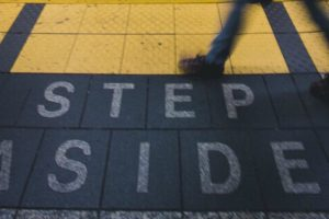 Step Aside written on ground