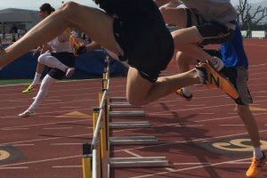 Runners clearing hurdles