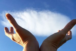 Hands holding a cloud