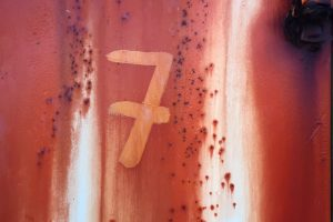 Number 7 on rusty wall