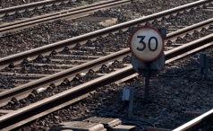 Number 30 sign on railroad tracks