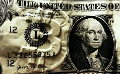 Dollar bill with embossed Bitcoin logo