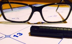 Calendar with glasses and marker