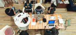 Group of developers working at a table looking from above